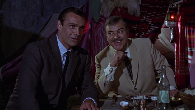 Bond and Karim Bey enjoy the gypsy show.