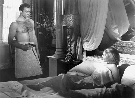 Bond finds Romanova in his bed. Hard to get apparently was chucked out the window in the 60s.